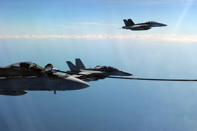 NORTHERN TERRITORY, ACT, Australia (July 13, 2015) - A Royal Australian Air Force KC-30A Multi Role Tanker Transport refuels a RAAF F/A-18 Hornet alongside other U.S. and Australian fighters during a refueling training exercise as part of Talisman Sabre 2015.  U.S. and Australian forces are conducting air refueling missions throughout the Talisman Sabre 2015 exercise to improve interoperability and familiarization with each other's procedures. Talisman Sabre is a biennial exercise that provides an invaluable opportunity for nearly 30,000 U.S. and Australian defense forces to conduct operations in a combined, joint and interagency environment that will increase both countries' ability to plan and execute a full range of operations from combat missions to humanitarian assistance efforts.
