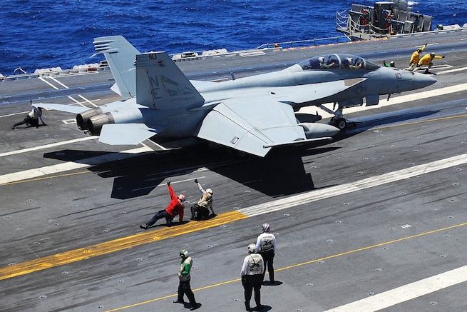 u s department of > photos > photo essays > essay view aboard the uss ronald reagan u s navy sailors launch an f a 18f super hornet assigned to strike