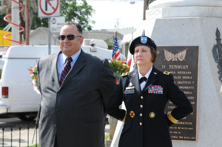 U.S. Army Maj. Gen. Megan Tatu, right, the commanding general of the 79th Sustainment Support Command, stands alongside California State Assembly Speaker John A. Perez at the All Wars Memorial in Cinco Puntos just prior to the 66th Annual Memorial Day Observance in East Los Angeles, May 27, 2013. (U.S. Army photo by Sgt. 1st Class Corey Beal/Released)
