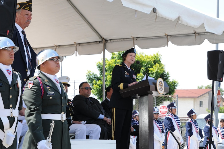 U.S. Army Maj. Gen. Megan Tatu, center, the commanding general of the 79th Sustainment Support Command, speaks to elected officials, veterans and more than 300 community members during the 66th Annual Memorial Day observance at Cinco Puntos in East Los Angeles, May 27, 2013. (U.S. Army photo by Sgt. 1st Class Corey Beal/Released)