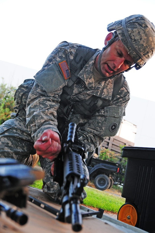 Spc. Ethan Berton, a signal support specialist with the 483rd Transportation Battalion, 311th Expeditionary Sustainment Command, assembles a weapon as part of a Mystery Event during the Best Warrior Competition hosted by the 79th Sustainment Support Command at Joint Forces Training Base, Los Alamitos, Calif., April 19, 2015. The Best Warrior Competition seeks out the best candidate that defines a U.S. Army Soldier by testing Soldiers physically and mentally. The competition will consist of one enlisted Soldier and one noncommissioned officer from four separate one-star commands, which fall underneath the command and control of 79th SSC. At the conclusion, one Soldier and one NCO will be named the 79th SSC Best Warrior and represent the command in the U.S. Army Reserve Best Warrior Competition held at Fort Bragg, N.C., from May 4-8, 2015. (U.S. Army photo by Spc. Heather Doppke/released)