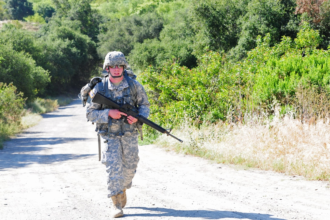 Cpl. Bryan Ohlendorf, a water purification specialist with the 383rd Quartermaster Company, 451st Expeditionary Sustainment Command, conducts a 6.2-mile ruck march during the Best Warrior Competition hosted by the 79th Sustainment Support Command at Camp Pendleton, Calif., April 18, 2015. The Best Warrior Competition seeks out the best candidate that defines a U.S. Army Soldier by testing Soldiers physically and mentally. The competition will consist of one enlisted Soldier and one noncommissioned officer from four separate one-star commands, which fall underneath the command and control of 79th SSC. At the conclusion, one Soldier and one NCO will be named the 79th SSC Best Warrior and represent the command in the U.S. Army Reserve Best Warrior Competition held at Fort Bragg, N.C., May 4-8, 2015. (U.S. Army photo by Spc. Heather Doppke/released)