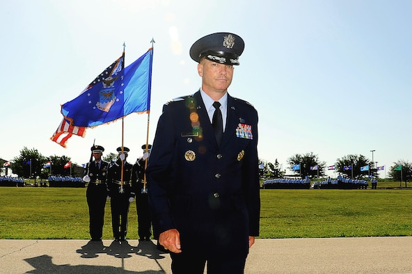 U.S. Air Force Col. Michael L. Downs, 17th Training Wing Commander, steps to the podium to address the crowd after assuming command during the 17th TRW Change of Command Ceremony at the parade field on Goodfellow Air Force Base, Texas, July 14, 2015. Downs is the 45th base commander and commands four groups, including three geographically separated units, with the mission to develop exceptional Intelligence, Surveillance and Reconnaissance and Fire Protection Professionals for America and Her Allies.  (U.S. Air Force photo by Tech. Sgt. Austin Knox/Released)