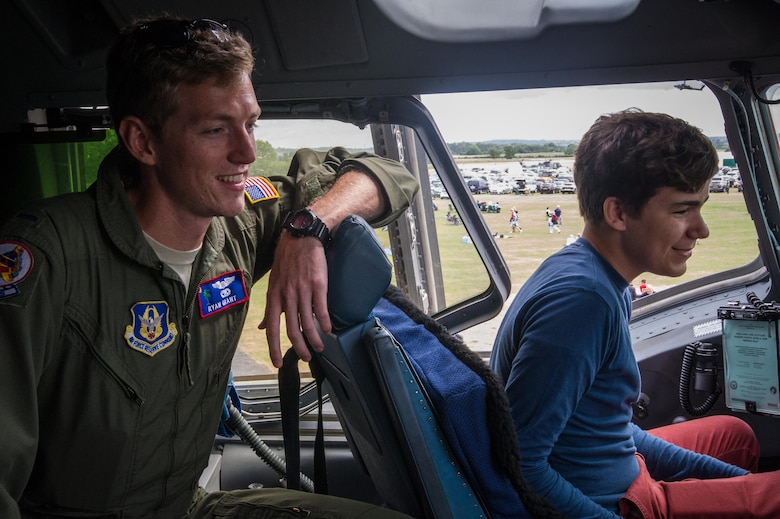 """1st Lt. Ryan Grant gives a tour in the cockpit of a C-17 at Royal Naval Air Station Yeovilton International Air Day July 11, 2015. Recognized for """"Best Static Display"""" at the air show, Airmen from the 315th Airlift Wing at Joint Base Charleston, S.C. delivered military pride, strength and technology with a C-17 and gave tours of the aircraft to more than 2,000 people. The air show marked 75 years of existence for RNAS Yeovilton and provided the 315th AW an international stage to showcase its Airmen, aircraft and partnership with the United Kingdom. Grant is a pilot with the 701st Airlift Squadron.  (U.S. Air Force photo by Tech. Sgt. Shane Ellis)"""