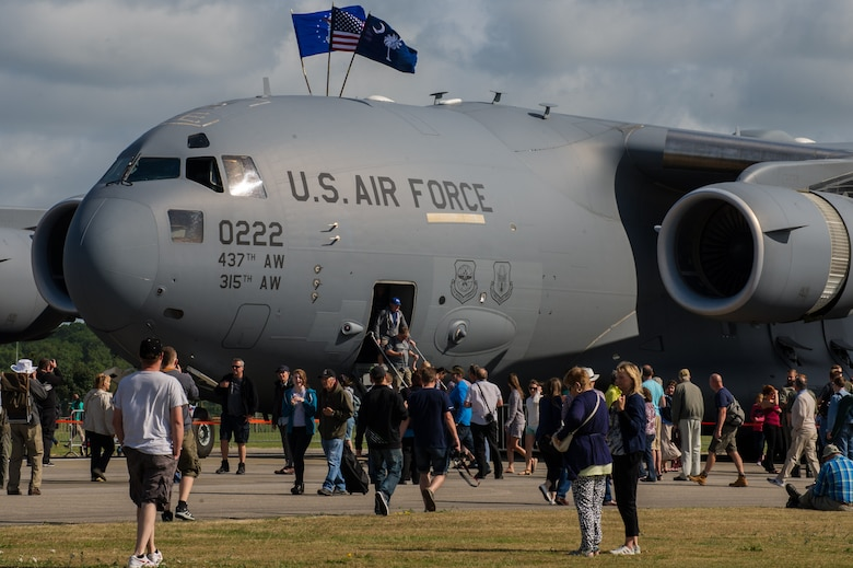 """Air-show visitors get an up-close look of a Charleston based C-17 at Royal Naval Air Station Yeovilton International Air Day July 11, 2015. Recognized for """"Best Static Display"""" at the air show, Airmen from the 315th Airlift Wing at Joint Base Charleston, S.C. delivered military pride, strength and technology with a C-17 and gave tours of the aircraft to more than 2,000 people. The air show marked 75 years of existence for RNAS Yeovilton and provided the 315th AW an international stage to showcase its Airmen, aircraft and partnership with the United Kingdom. (U.S. Air Force photo by Tech. Sgt. Shane Ellis)"""