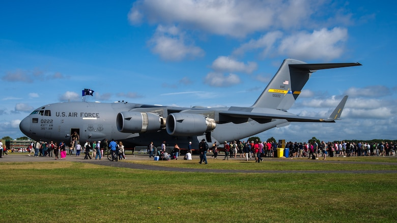"""Air-show visitors wait in line to get a tour of the Charleston based C-17 at Royal Naval Air Station Yeovilton International Air Day July 11, 2015. Recognized for """"Best Static Display"""" at the air show, Airmen from the 315th Airlift Wing at Joint Base Charleston, S.C. delivered military pride, strength and technology with a C-17 and gave tours of the aircraft to more than 2,000 people. The air show marked 75 years of existence for RNAS Yeovilton and provided the 315th AW an international stage to showcase its Airmen, aircraft and partnership with the United Kingdom. (U.S. Air Force photo by Tech. Sgt. Shane Ellis)"""