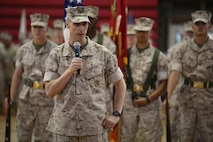 Brig. Gen. Robert Castellvi, deputy commanding general, II Marine Expeditionary Force, and reviewing officer, addresses the audience during the Ground Combat Element Integrated Task Force deactivation ceremony at the Goettge Memorial Field House, Marine Corps Base Camp Lejeune, North Carolina, July 14, 2015. From October 2014 to July 2015, the GCEITF conducted individual and collective level skills training in designated ground combat arms occupational specialties in order to facilitate the standards-based assessment of the physical performance of Marines in a simulated operating environment performing specific ground combat arms tasks. (U.S. Marine Corps photo by Sgt. Alicia R. Leaders/Released)