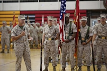 Col. Matthew G. St. Clair, Ground Combat Element Integrated Task Force Commanding Officer, addresses the audience during unit's deactivation ceremony at the Goettge Memorial Field House, Marine Corps Base Camp Lejeune, North Carolina, July 14, 2015. From October 2014 to July 2015, the GCEITF conducted individual and collective level skills training in designated ground combat arms occupational specialties in order to facilitate the standards-based assessment of the physical performance of Marines in a simulated operating environment performing specific ground combat arms tasks. (U.S. Marine Corps photo by Sgt. Alicia R. Leaders/Released)