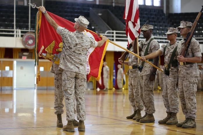Sgt. Maj. Robin C. Fortner, left, Ground Combat Element Integrated Task Force Sergeant Major, and Col. Matthew G. St. Clair, GCEITF Commanding Officer, case the Task Force colors during the unit's deactivation ceremony at the Goettge Memorial Field House, Marine Corps Base Camp Lejeune, North Carolina, July 14, 2015. From October 2014 to July 2015, the GCEITF conducted individual and collective level skills training in designated ground combat arms occupational specialties in order to facilitate the standards-based assessment of the physical performance of Marines in a simulated operating environment performing specific ground combat arms tasks. (U.S. Marine Corps photo by Sgt. Alicia R. Leaders/Released)