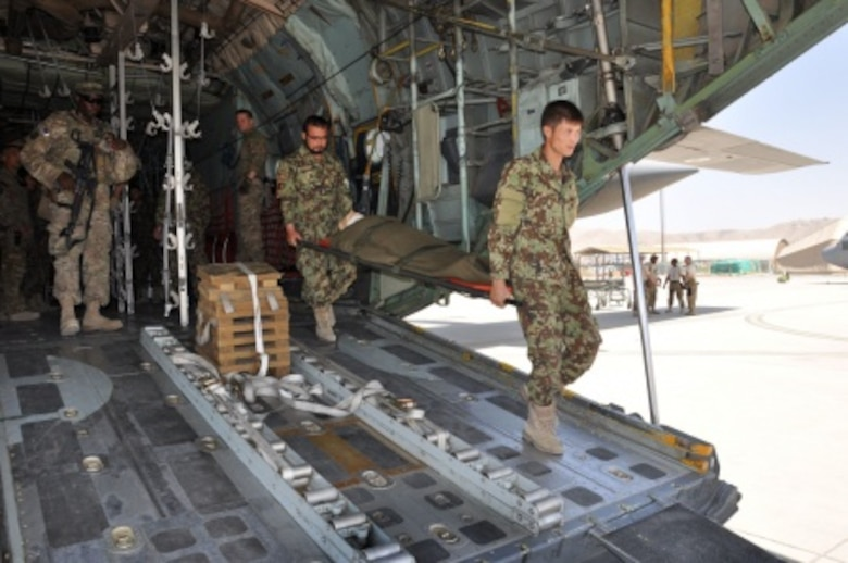 Two Afghan National Army flight medics carry a litter, or stretcher, from the back of a C-130H Hercules during a simulated medical evacuation flight at Hamid Karzai International Airport, Afghanistan, July 9, 2015. The Train, Advise, Assist Command - Air (TAAC-Air) advisors provide weekly training to the ANA and Afghan air force to further develop and grow their fight medics' capabilities. (U.S. Air Force photo/Capt. Eydie Sakura)