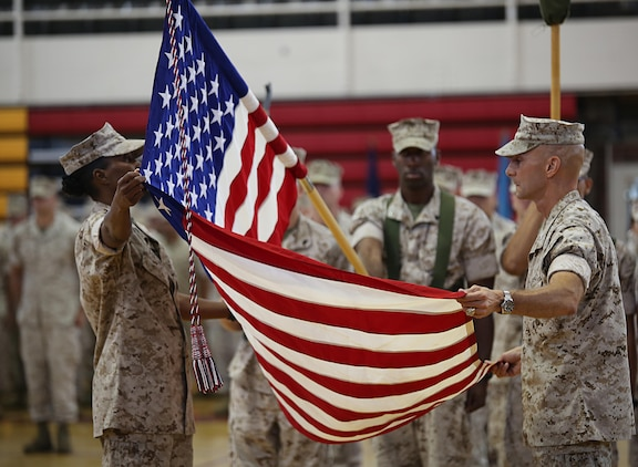 Sgt. Maj. Robin C. Fortner, left, Ground Combat Element Integrated Task Force Sergeant Major, and Col. Matthew G. St. Clair, GCEITF Commanding Officer, case the national ensign during the unit's deactivation ceremony at the Goettge Memorial Field House, Marine Corps Base Camp Lejeune, North Carolina, July 14, 2015. From October 2014 to July 2015, the GCEITF conducted individual and collective level skills training in designated ground combat arms occupational specialties in order to facilitate the standards-based assessment of the physical performance of Marines in a simulated operating environment performing specific ground combat arms tasks. (U.S. Marine Corps photo by Sgt. Alicia R. Leaders/Released)