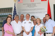 American and Albanian partners gather June 11 to celebrate the reopening of a local school in Kucove, Albania. U.S. Army Corps of Engineers Europe District managed a $575,000 renovation in support of U.S. Embassy Tirana's Office of Defense Cooperation...