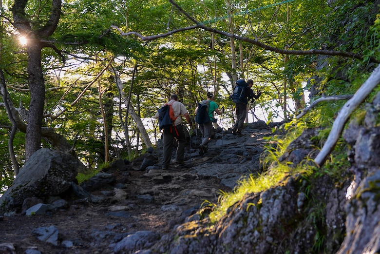 Members from Yokota Air Base, Japan, hike the Yoshida trail on the way to the summit of Mount Fuji, Japan, July 11, 2015. To make sure all 86 hikers returned safely from the mountain, hikers traveled alongside a wingman, keeping each other motivated along the way. (U.S. Air Force photo/Airman 1st Class Elizabeth Baker)