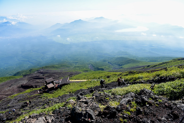 Hikers make their way up the Yoshida trail on their way to the summit of Mount Fuji, Japan, July 11, 2015. Airmen from Yokota Air Base used teamwork and resiliency to make sure that all members returned safely from the mountain. (U.S. Air Force photo/Airman 1st Class Elizabeth Baker)