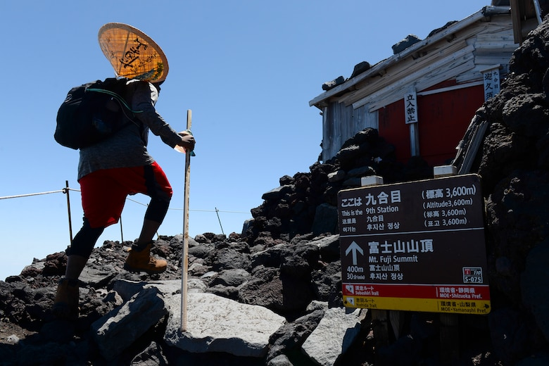 A hiker makes his way past the ninth station of the Yoshida trail on Mount Fuji, Japan, July 11, 2015. To reach the summit of Mount Fuji, hikers had to climb over 5,000 feet, taking anywhere from three to seven hours. Airmen from Yokota Air Base used teamwork and resiliency to make sure that all members returned safely from the mountain. (U.S. Air Force photo/Airman 1st Class Elizabeth Baker)