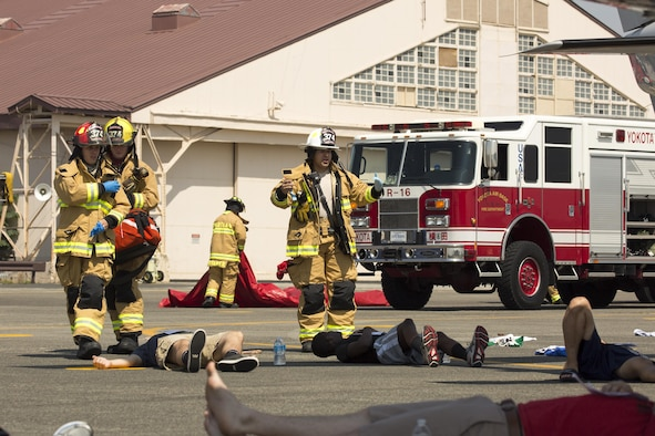 Yokota firefighters arrive on scene during an Emergency Management Exercise at Yokota Air Base, July 13, 2015. First responders have an essential role in exercises and real-world situations, and they continue to train to ensure preparedness for any situation. (U.S. Air Force photo by Osakabe Yasuo/Released)