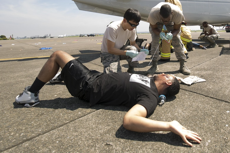 First responders from the 374th Medical Group arrive on scene and assess the situation during an Emergency Management Exercise at Yokota Air Base, Japan, July 13, 2015. The EME trained Yokota for possible real-world situations requiring response and communication between on-base organizations. (U.S. Air Force photo by Osakabe Yasuo/Released)