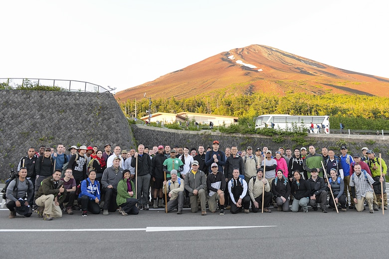 Members of Team Yokota pose with Chief Master Sergeant of the Air Force James A. Cody at the 5th station before beginning the hike to the summit of Mount Fuji, Japan, July 11, 2015. Hikers bus to the 5th station at nearly 7,000 ft. altitude before beginning the trek. (U.S. Air Force photo by Airman 1st Class Elizabeth Baker/Released)