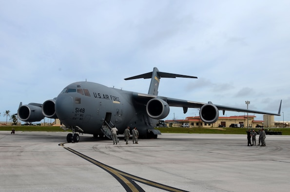 A C-17 Globemaster III assigned to the Hawaii Air National Guard at Joint Base Pearl Harbor-Hickam, Hawaii, arrives at Andersen Air Force Base, Guam, July 15, 2015, after evacuating more than 125 Department of Defense members from Wake Island in preparation for potential surges caused by Typhoon Halola. An evacuation mission such as this highlights Pacific Air Force's flexibility to generate air response quickly across the theater, which is a key component to air power. The DoD personnel are part of the Pacific Air Forces Regional Support Center and 11th Air Force mission on Wake Island, which is a strategic location within the Pacific and also a divert airfield for overseas flights. (U.S. Air Force photo by Airman 1st Class Alexa A. Henderson/Released)