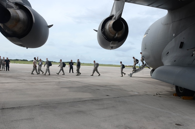 More than 125 Department of Defense members and contractors arrive at Andersen Air Force Base, Guam, July 15, 2015, after evacuation from Wake Island in preparation for potential surges caused by Typhoon Halola. An evacuation mission such as this highlights Pacific Air Forces flexibility to generate air response quickly across the theater, which is a key component to air power. (U.S. Air Force photo by Airman 1st Class Alexa A. Henderson/Released)
