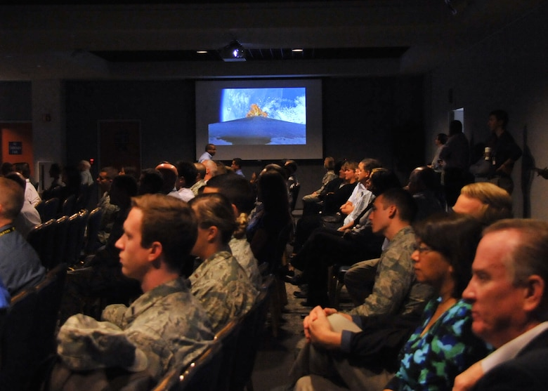 """An audience of more than 150 Space and Missile Systems Center personnel watch the on-board camera perspective of the first stage performance of an Atlas V in the Gordon Conference Center at Los Angeles Air Force Base in El Segundo, Calif. On July 15, 2015, a United Launch Alliance Atlas V in the """"401"""" vehicle configuration of a four-meter-wide payload fairing, zero solid rocket boosters and a single engine upper stage successfully carried a GPS IIF-10 satellite into orbit at 11:36 a.m. EDT from Launch Complex 41 at Cape Canaveral Air Force Station in Florida for the Global Positioning System navigation network. (U.S. Air Force photo/Sarah Corrice)"""