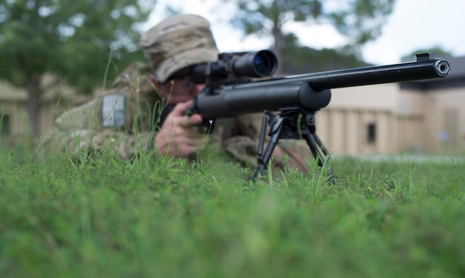 U.S. Air Force Staff Sgt. Joseph Crotty, 822d Base Defense Squadron NCO in charge of standards and evaluations, gazes down the sights of his M24 Sniper Weapon System while in the prone position July 2, 2015, at Moody Air Force Base, Ga. Crotty and Senior Airman Phillip Hopkins, 822d Base Defense Squadron fireteam leader, attended a nine-week sniper training course to develop their knowledge and skills. (U.S. Air Force photo by Staff Sgt. Eric Summers Jr./Released)