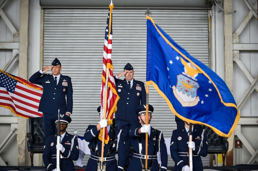 Colonel John Lamontagne (left) and Col. Fred Boehm salute the flag July 15, 2015, during the 437th Operations Group change of command at Joint Base Charleston, S.C. Boehm has served as the 437th OG commander since July 2013.  Following the change of command, Boehm's next assignment will take him to Saudi Arabia where he will be the chief of the Joint Advisory Division for Saudi Arabia. Lamontagne is the 437th Airlift Wing commander. (U.S. Air Force photo/Senior Airman Jared Trimarchi)