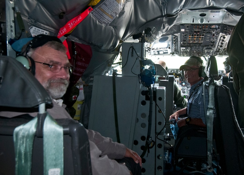 Civilian employers of National Guard and Reserve service members observe the operations inside a KC-135R Stratotanker cockpit July 14, 2015, during an ESGR Boss-lift. The ESGR Boss-lift is a day set to educate civilian employers of National Guard and Reserve service members as to what their employees accomplish while on military duty. (U.S. Air Force photo by Airman 1st Class Morgan R. Lipinski/Released)