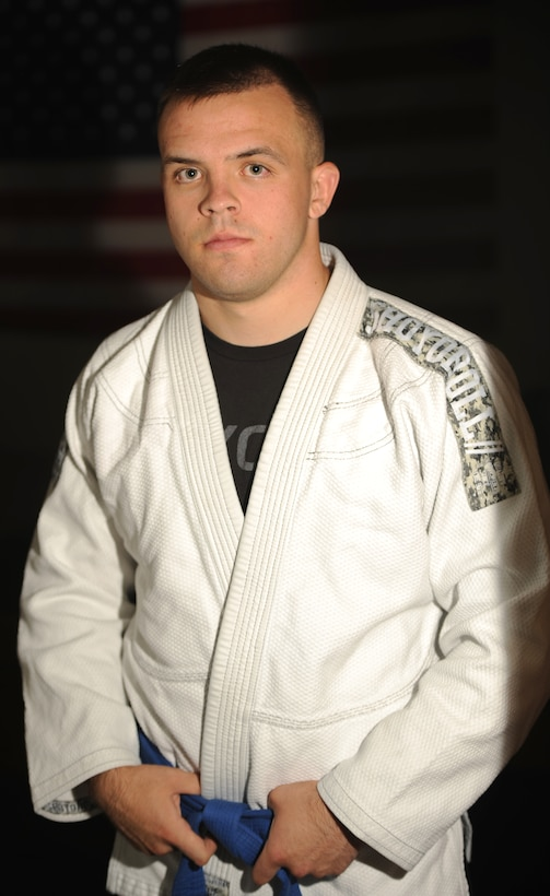 Airman 1st Class Larry, 48th Intelligence Squadron mission system technician, poses in a Brazilian Jiu Jitsu outfit at Beale Air Force Base, California, July 7, 2015. (U.S. Air Force photo by Airman Preston L. Cherry)