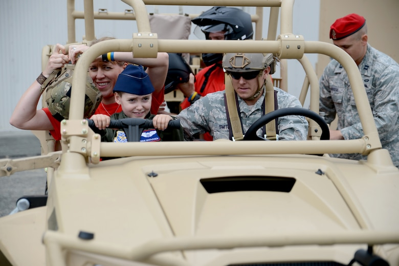 Ewan McFadgen, Pilot for a Day, rides in a light tactical all-terrain vehicle July 10, 2015, during his tour of Joint Base Lewis-McChord, Wash. Along his tour, McFadgen and his family learned about the various missions and responsibilities of the squadrons on McChord Field. (U.S. Air Force photo/Airman 1st Class Keoni Chavarria)