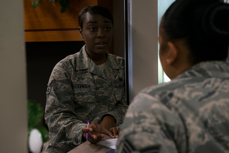 U.S. Air Force Senior Airman Kiandra Alexander, 23d Logistics Readiness Squadron traffic management journeyman, briefs Staff Sgt. Sarita Fair, 23d Force Support Squadron lodging assistant manager, in the traffic management office July 9, 2015, at Moody Air Force Base, Ga. TMO is responsible for moving personal property and cargo movement as well as passenger travel arrangements for PCS, TDY and deployments. (U.S. Air Force photo by Airman 1st Class Kathleen D. Bryant/Released)