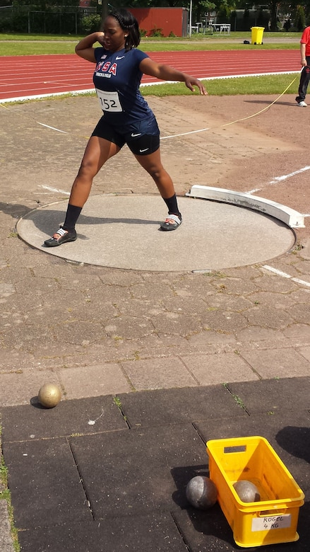 Airman 1st Class Jessica Johnson, a 4th Aerospace Medicine Squadron public health technician, prepares to throw a shot put May 27, 2015, at the 2015 Headquarters Aircom Inter-Nation Athletics Championship in Amsterdam. Johnson threw the shot 11.44 meters, finishing the competition in second place, and contributing to the U.S. Air Forces in Europe – Air Forces Africa women's team taking home the gold medal. (Courtesy photo)