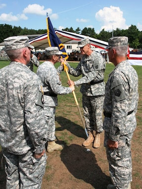 Left center, Brig. Gen. Paul M. Benenati, the outgoing commanding general of the 7th Civil Support Command, passes the unit colors to Maj. Gen. John R. O'Connor, the commanding general of the 21st Theater Sustainment Command, relinquishing his command as, on right, Brig. Gen. Arlan M. DeBlieck, the incoming commanding general of the 7th CSC, watches during the change of command ceremony on Daenner Kaserne, July 26. (Photo by Staff Sgt. Jason G. Weber, 221st Public Affairs Detachment, 7th CSC)