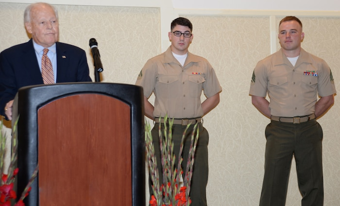 Two Marines from Marine Corps Logistics Base Albany receive recognition for their service to the community and to the Marine Corps during the annual Military Appreciation Rise and Shine Breakfast at the Hilton Garden Inn in downtown Albany, Georgia, July 15.  Lance Cpl. Ethan Kortie, administrative specialist, received the award for Marine of the Year, (center) and Sgt. Steven McGahee, postal noncommissioned officer, Adjutant's Office, MCLB Albany, received recognition as Noncommissioned Officer of the Year.