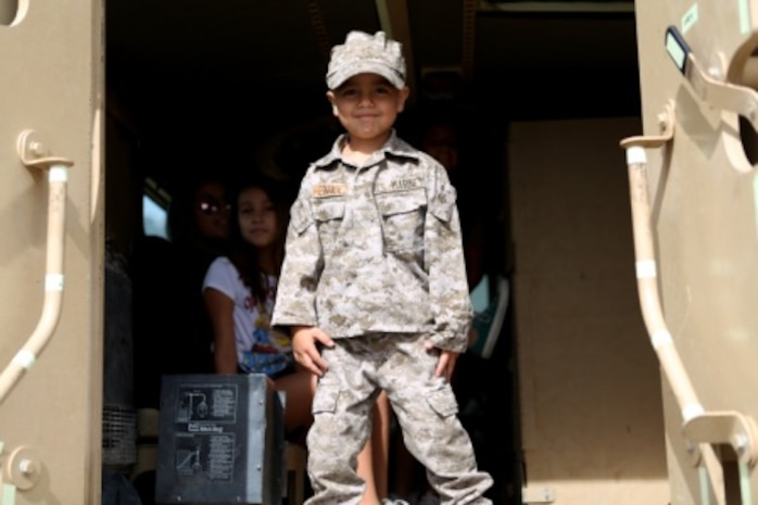 Haydn, the son of Staff Sgt. Henry Hernandez, looks out from the back of an armored truck at a family day held by 7th Engineer Support Battalion, 1st Marine Logistics Group, aboard Camp Pendleton, Calif., July 10, 2015. Included in the celebration were bouncy houses and displays that allowed them to look at things like sniper rifles, armored vehicles and Explosive Ordnance Disposal gear.