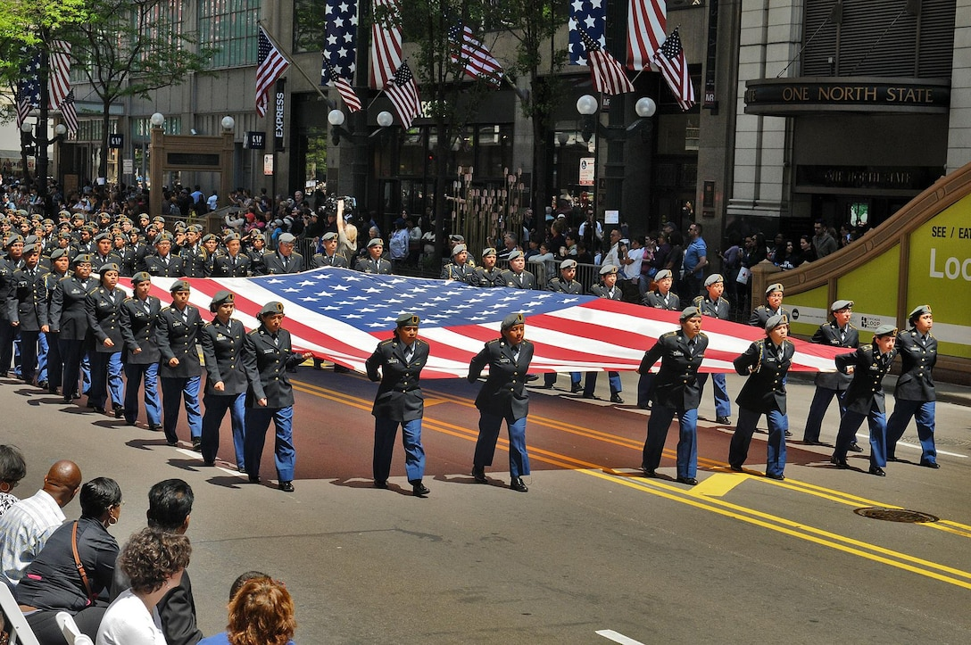 Junior Reserve Officers Training Corps cadets march down State Street in Chicago carrying the American flag during the City of Chicago's Memorial Day parade on May 23. Forty-five JROTC schools and academies were represented there with more than 6,000 cadets marching in the parade. (U.S. Army photo by Sgt. Aaron Berogan)