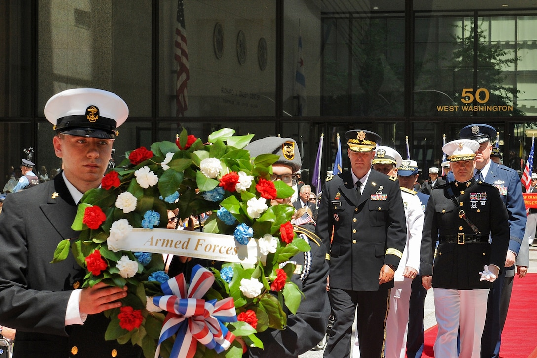 Senior leaders from each branch of the Armed Forces present an Armed Forces wreath during a wreath laying ceremony in Chicago May 23. The wreath laying ceremony was held at the Richard J. Daley Plaza in Chicago during the city's Memorial Day commemoration there. (U.S. Army photo by Sgt. Aaron Berogan)