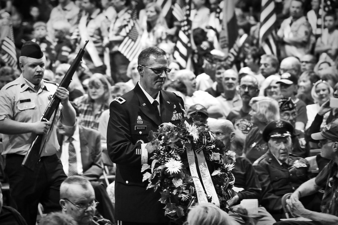 Brig. Gen. Frederick R. Maiocco Jr., commanding general of the 85th Support Command, presents a wreath during a Memorial Day commemoration held in Arlington Heights, Ill., May 25. Maiocco joined a variety of veterans, local police and fire officials as well as local and federal dignitaries in presenting wreaths there. (U.S. Army photo by Sgt. 1st Class Anthony L. Taylor/Released)