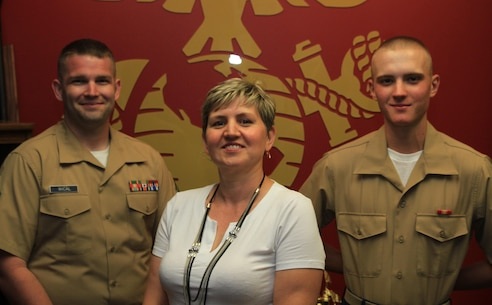 Ewa Perkowski, (middle) her son, Pvt. Dawid Perkowski (right), and Sgt. Justin Wical, take a moment to post for a photo at Marine Corps Recruiting Substation Reading, recently. Perkowski is a second-generation immigrant from Poland, where his parents knew a different meaning to military service. After some convincing from her son, and an in depth education about the Marine Corps' rich history and traditions from Sgt. Wical, Ewa her family could not be more proud of their new Marine.