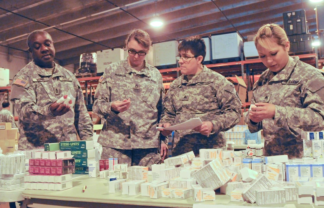 From left, Master Sgt. Michael Moffit, Staff Sgt. Ann Raisor, Sgt. Darlene Gleason and Sgt. Elizabeth Cillian of the Army Reserve's 7241st Medical Support Unit stationed in Lexington, Ky., prepare equipment for an Innovative Readiness Training mission at the 99th Regional Support Command's medical storage and maintenance facility on Joint Base McGuire-Dix-Lakehurst, N.J. This facility provides a 60,000-square-foot, solar-powered, climate-controlled facility that offers the 3rd Medical Deployment Support Command storage space for medical, dental, veterinary, forward surgical and early entry hospital equipment, as well as maintenance capabilities for bio-medical equipment and X-ray, ventilator and defibrillator repair.