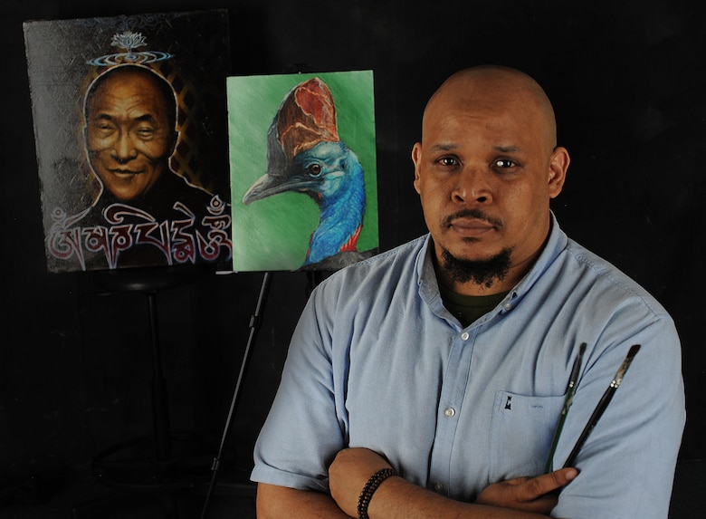 Kevin Lewis, an 86th Force Support Squadron program coordinator, stands by some of his artwork June 29, 2015, at Ramstein Air Base, Germany. One of Lewis' portraits of the late hip-hop producer J Dilla will be displayed in a memorial exhibit at the Smithsonian Institution in Washington, D.C., on July 17, 2015. (U.S. Air Force photo/Airman 1st Class Larissa Greatwood)