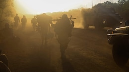 U.S. Marines and Australian service members move into defensive positions for the night after conducting an amphibious assault at Fog Bay, Australia, July 11, 2015. The Marines with Company E, Battalion Landing Team 2nd Battalion, 5th Marines, 31st Marine Expeditionary Unit, and Australians with Combat Team Bravo, 2nd Battalion, Royal Australian Regiment, assaulted the beach and moved inland to secure additional objectives as part of Talisman Sabre 2015.  Talisman Sabre is a biennial exercise designed to improve the interoperability between Australian and U.S. forces. The 31st MEU is taking part in the exercise while deployed on its regularly scheduled Fall Patrol of the Asia-Pacific region.