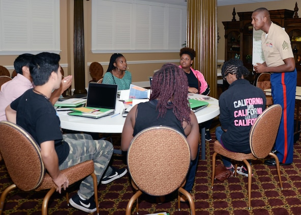 """Sgt. Marcus Keyes, recruiter, Recruiting Station Jacksonville, Fla., listens to a question from a student during the """"Life After High School"""" seminar at the Town and Country Restaurant's Grand Ballroom aboard Marine Corps Logistics Base Albany, July 14."""