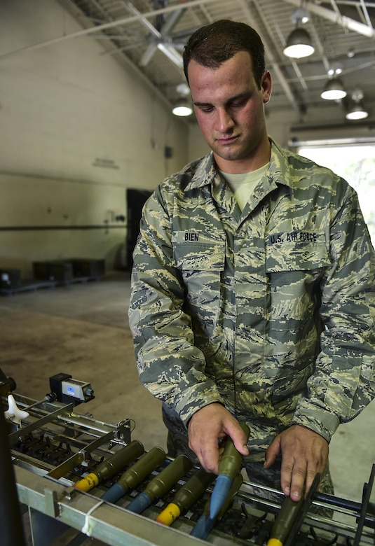 Senior Airman Alexander Bien, a 1st Special Operations Equipment Maintenance Squadron conventional maintenance crew chief, loads the 25mm processor at Hurlburt Field, Fla., June 23, 2015. The 25mm processor loads the ammunition into linked tube carriers for transport to the flightline. (U.S. Air Force photo/Senior Airman Jeff Parkinson)