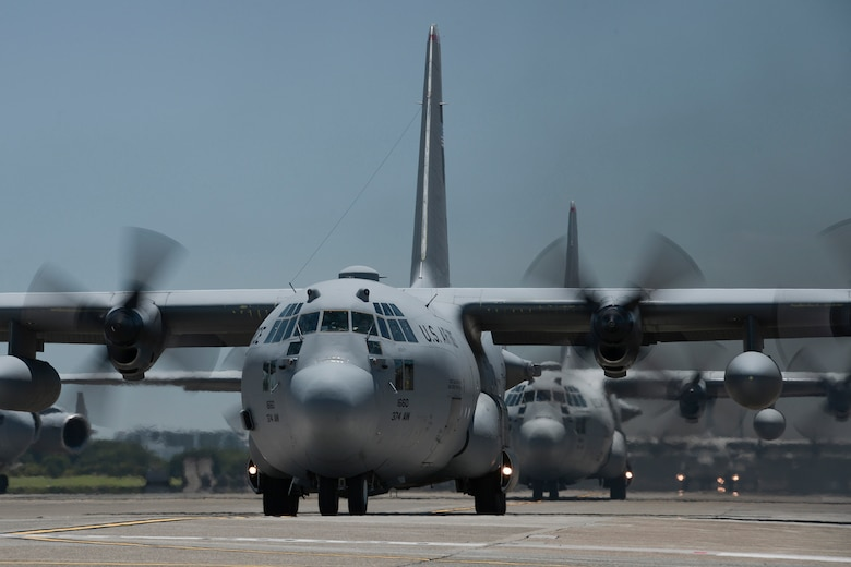 Multiple U.S. Air Force C-130 Hercules with the 374th Airlift Wing taxi during large formation training, Yokota Air Base, Japan, July 14, 2015. The training allowed aircrews an opportunity to practice their large formation and airlift capabilities. (U.S. Air Force photo by Staff Sgt. Cody H. Ramirez/Released)
