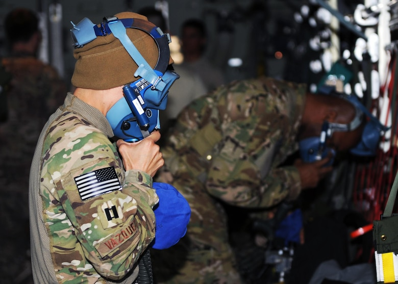 U.S. Air Force Capt. Maria Vazquez, 455th Expeditionary Aeromedical Evacuation Squadron flight nurse, tests an oxygen mask in preparation for an AE mission April 19, 2015 at Bagram Airfield, Afghanistan. 455 EAES Airmen are charged with the responsibility of evacuating the sick and wounded from Central Command to higher echelons of medical care. (U.S. Air Force photo by Staff Sgt. Whitney Amstutz/released)