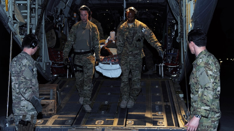 U.S. Air Force Tech. Sgts. Alexander Finn and Johnny Busby, 455th Expeditionary Aeromedical Evacuation Squadron technicians, transport a patient from a C-130 Hercules to an ambulance in Southwest Asia, April 19, 2015. Part of what makes this possible is that the C-130 is a pressurized aircraft specially designed to minimize the negative effects of altitude on patients, while ensuring rapid transport to higher levels of medical care. C-130-type aircraft are equipped with electrical and oxygen systems to support and accommodate specialized aeromedical evacuation equipment and enable medical Airmen to provide the necessary care to patients. (U.S. Air Force photo by Staff Sgt. Whitney Amstutz)