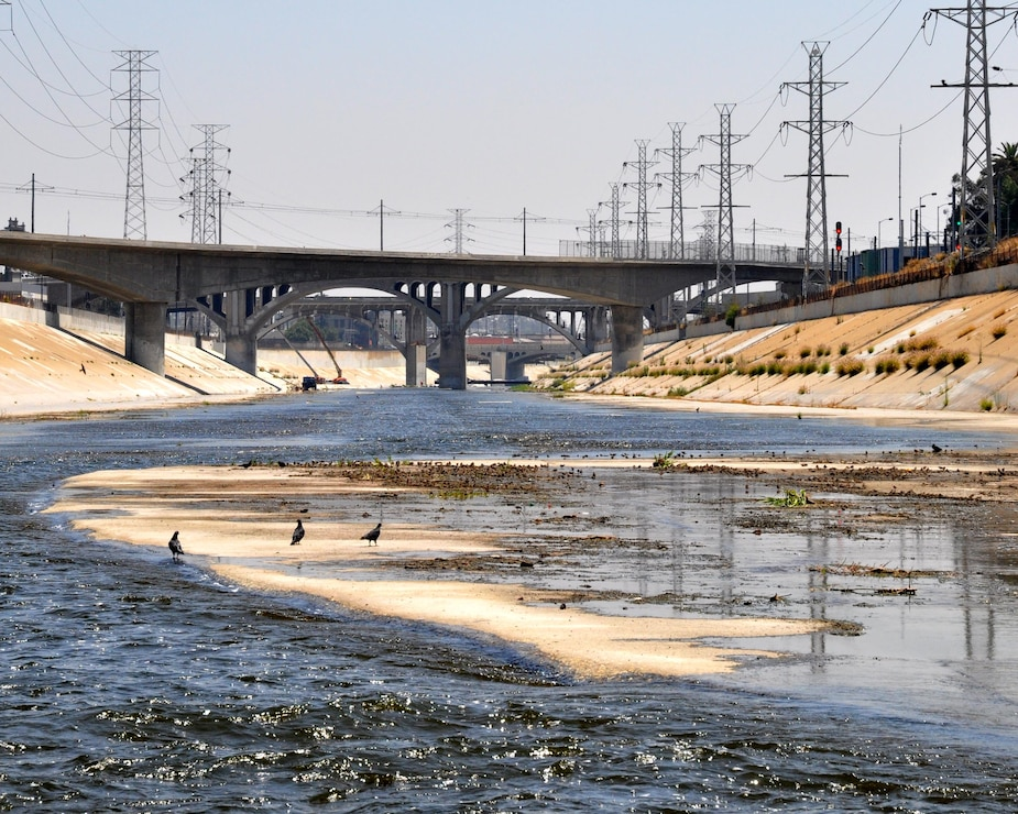 Water flows through the concrete channel of the Los Angeles River on its journey towards the Pacific Ocean Aug. 12, 2013.