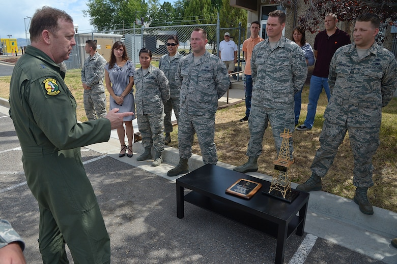 """Maj. Gen. Richard Scobee, 10 Air Force commander, presents the """"Golden Derrick Award"""" to the 419th Logistics Readiness Squadron fuels management flight during his visit here July 15. (U.S. Air Force photo/Alex Lloyd)"""