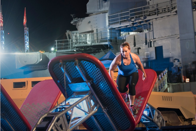 Air Force Capt. Kali Green assigned to the 24th Air Force, 5th Combat Communication Group, focuses on not falling during the quintuplet steps obstacle during the military edition, American Ninja Warrior challenge that aired July 6, 2015. Green trained five days a week at a ninja warrior and rock climbing gym to prepare herself. (Courtesy photo/Released)